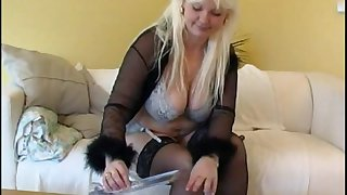 Chubby housewife in stockings plays