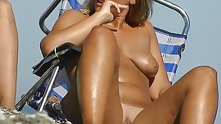 Sexy babes filmed playing on the nudist  beach absolutely na