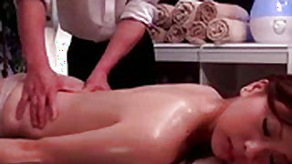 Experienced japanese masseur is doing body massage to the client