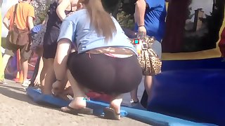 Milf's pink thong visible in public place