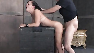 Tits tied tightly as the sub slut takes two dicks