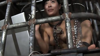 Asian in a cage uses her tongue as an ashtray