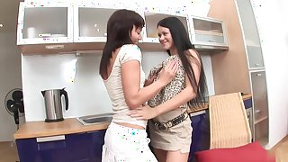 Milana and Monica get down and dirty on the kitchen counter