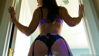 Ariana Marie posing in her purple lingerie